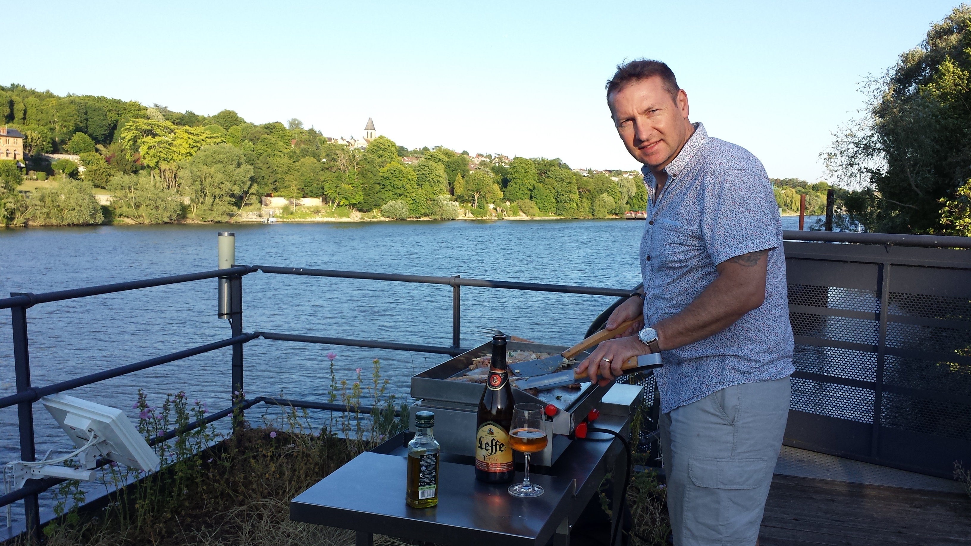 Tim cooks dinner on the top deck